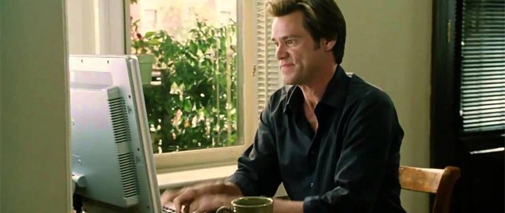 Bruce Almighty typing on a computer