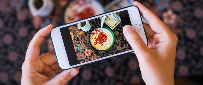 Taking photo of food on phone