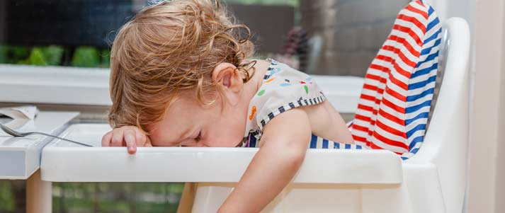 sleeping child in high chair