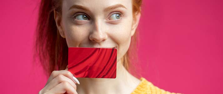 woman holding red card