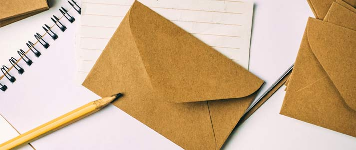 envelope with paper and pencil