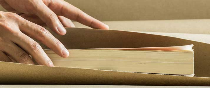 Book getting wrapped in brown paper