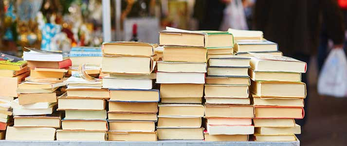 Books for sale on market stall