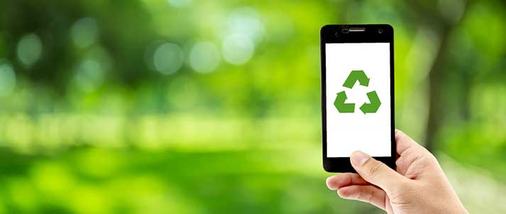 Person holding phone with recycle symbol