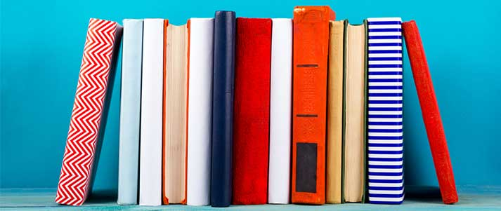 Colourful books with blue background
