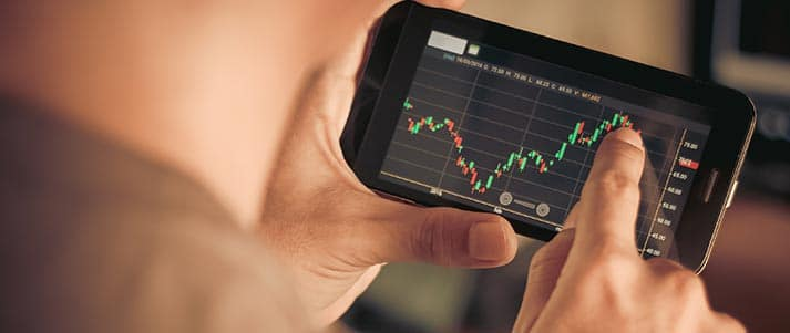 person viewing stock prices on phone