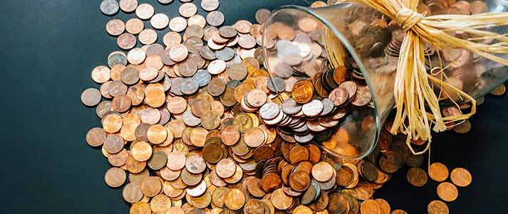 pennies spilling out of jar