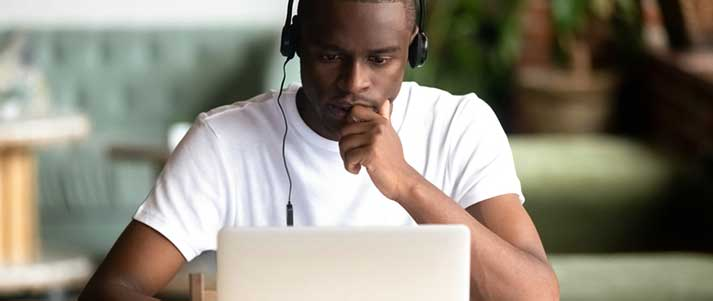 man on laptop concentrating
