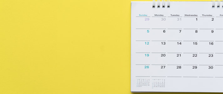 calendar in front of a yellow background