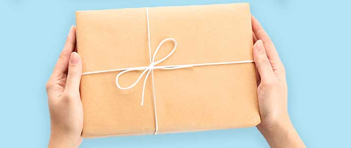 person holding parcel in brown paper